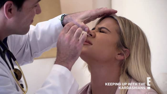 Khloé getting her nose swabbed for a medical test