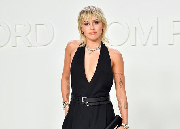 Miley Cyrus posing in a jumpsuit