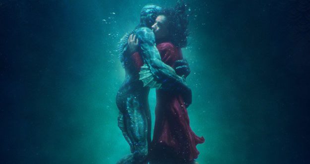 A still of Elisa Esposito and the Amphibian Man embracing underwater in The Shape of Water