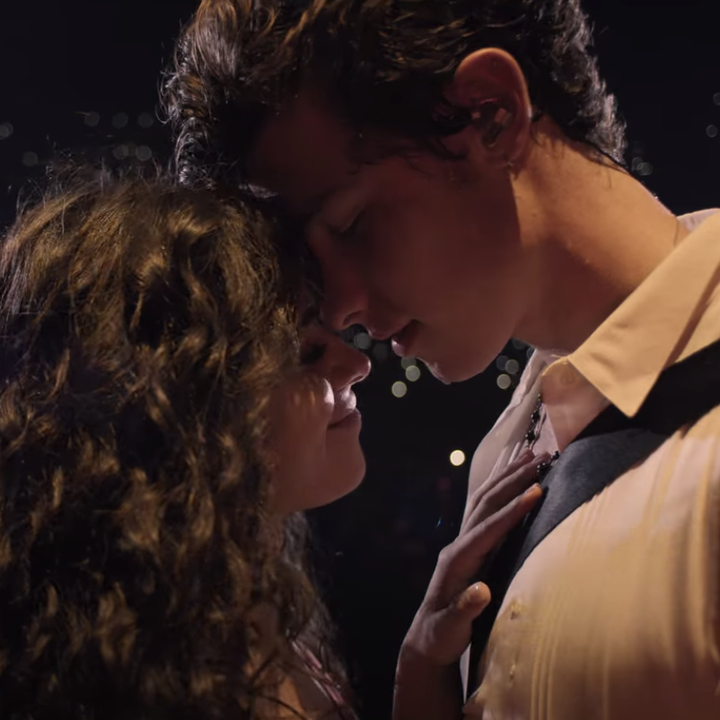 Shawn Mendes and Camilla Cabello sharing an intimate embrace on stage.