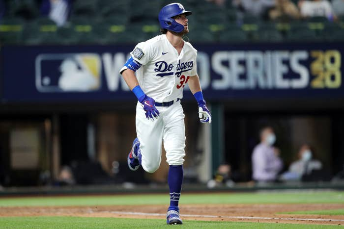 Cody Bellinger #35 of the Los Angeles Dodgers watches the flight of his two-run home run in the fourth inning during Game 1 of the 2020 World Series between the Los Angeles Dodgers and the Tampa Bay Rays.