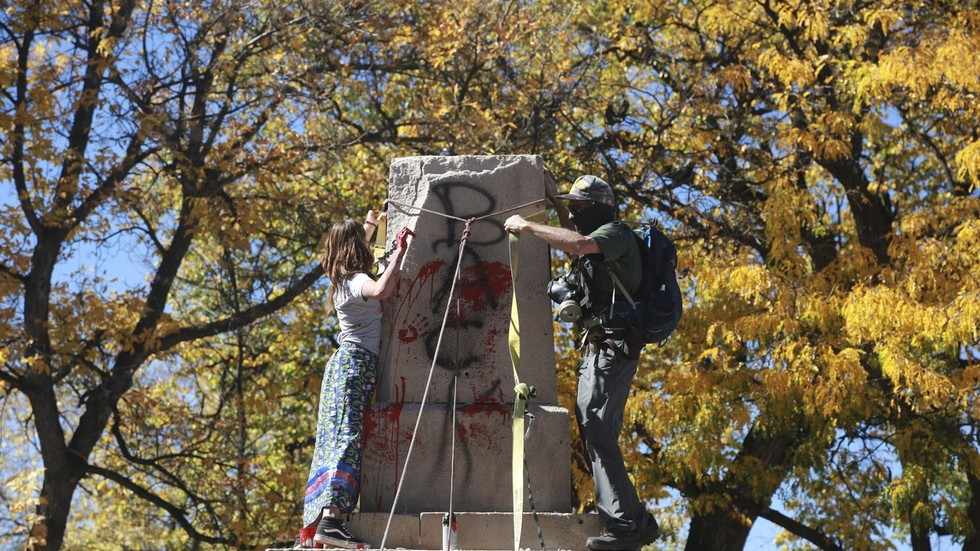 'This will no doubt end racism': Activists tear down 'offensive' monument on Columbus Day, but gesture draws heat online