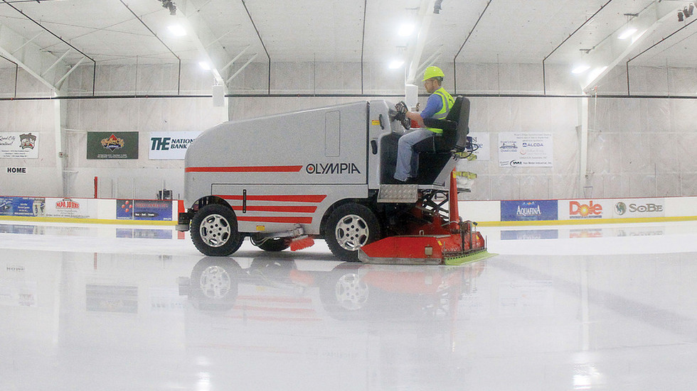 Snow laughing matter: WATCH bizarre moment zamboni catches fire on ice hockey rink in NY