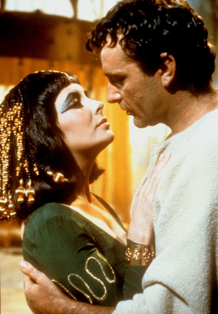 Cleopatra hugging Mark Antony and gazing into each other's eyes in the movie Cleopatra