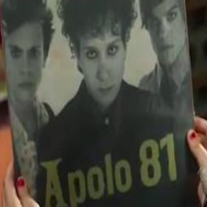 A vinyl record with a photo of three boys on the cover with 'Apolo 81' written on the front