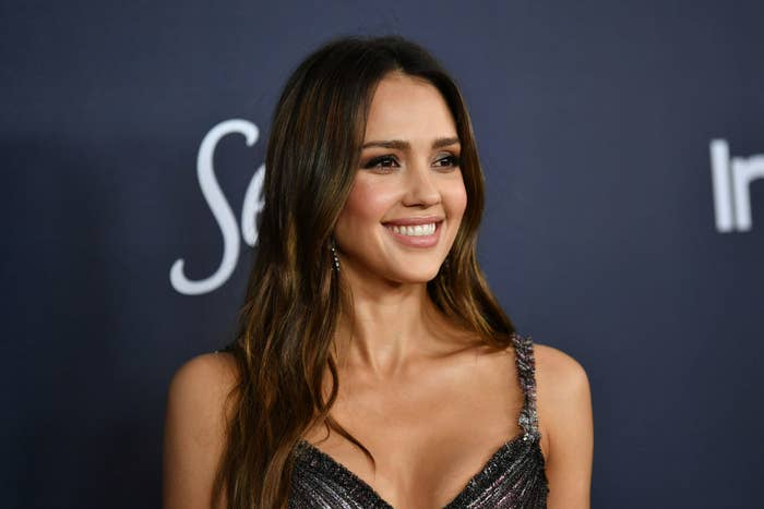 Jessica Alba poses at a red carpet event