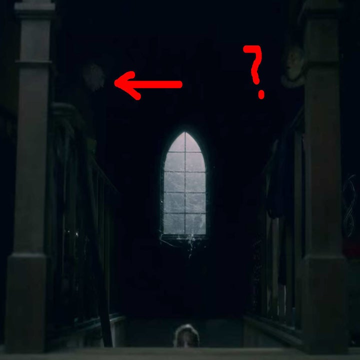 The dark stairs leading to the attic, a man's face appears on one side and a woman's shocked face appears on the other