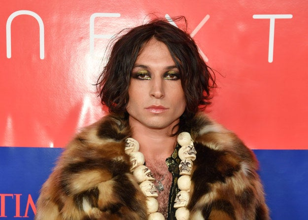 Ezra Miller in skull necklace and fur coat
