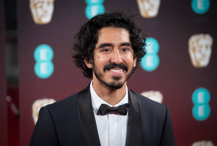 Dev Patel on the red carpet in a tux.