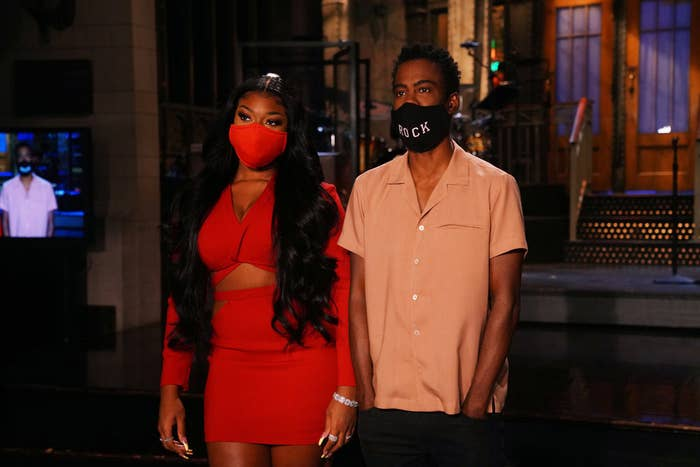 Megan Thee Stallion and Chris Rock wearing masks