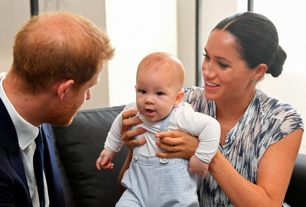 Meghan Markle holding baby Archie up