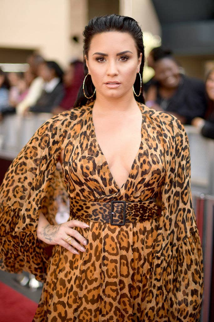 Demi posing in an animal print dress