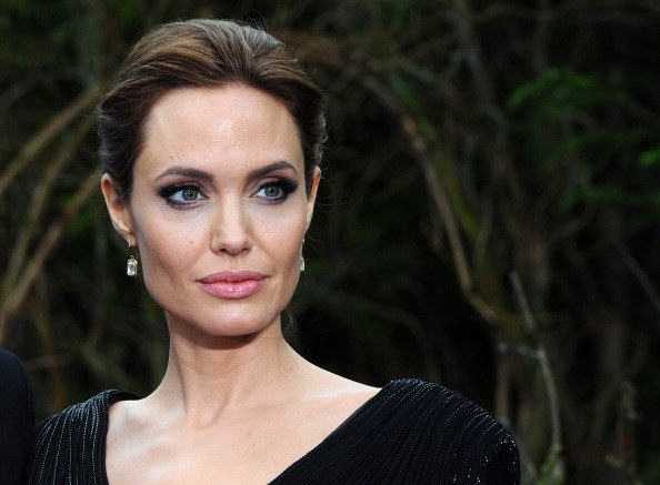 Angelina with heavy makeup and her hair up