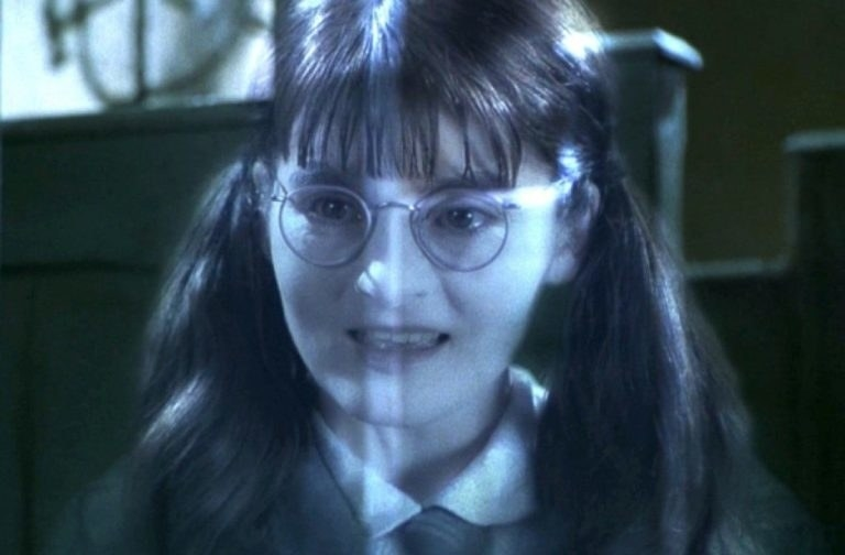 Moaning Myrtle talking to someone offscreen.