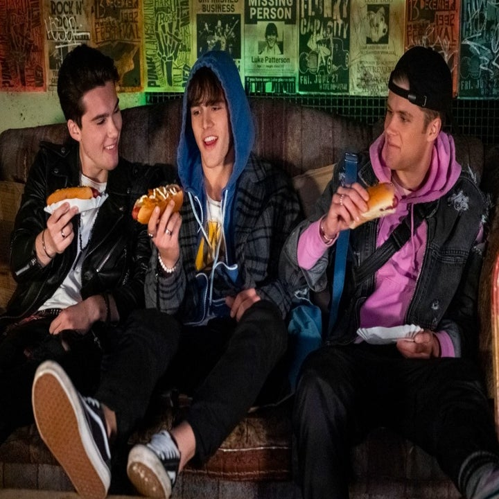 A still of the three boys in Sunset Curve eating hotdogs