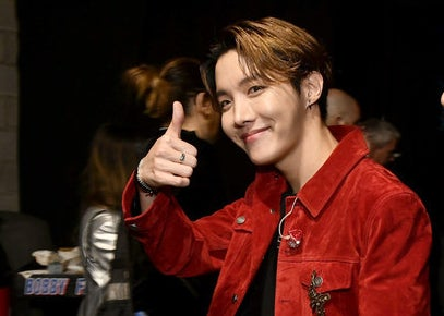J-Hope smiling and giving a thumbs up