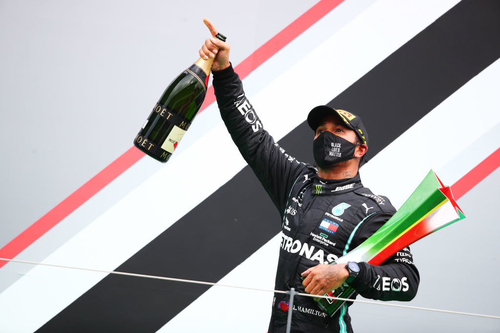 Race winner Lewis Hamilton of Great Britain and Mercedes GP celebrates his record breaking 92nd race win