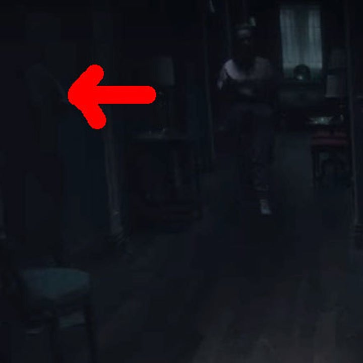 Dani walks through a dark hallway; a red arrow points to a shadowy figure