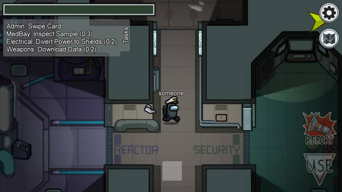 "A screenshot of the game ""Among Us"" with a player heading into the security room"
