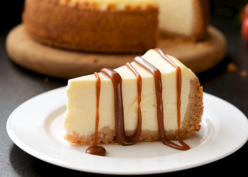 A slice covered in caramel drizzle