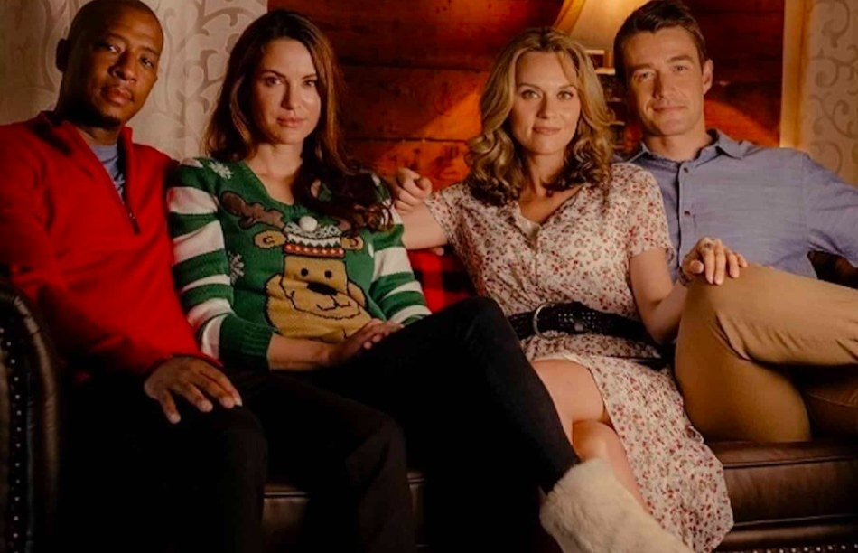 Promo image from The Christmas Contract: Antwon Tanner, Danneel Ackles, Hilarie Burton and Robert Buckley sit on a couch together