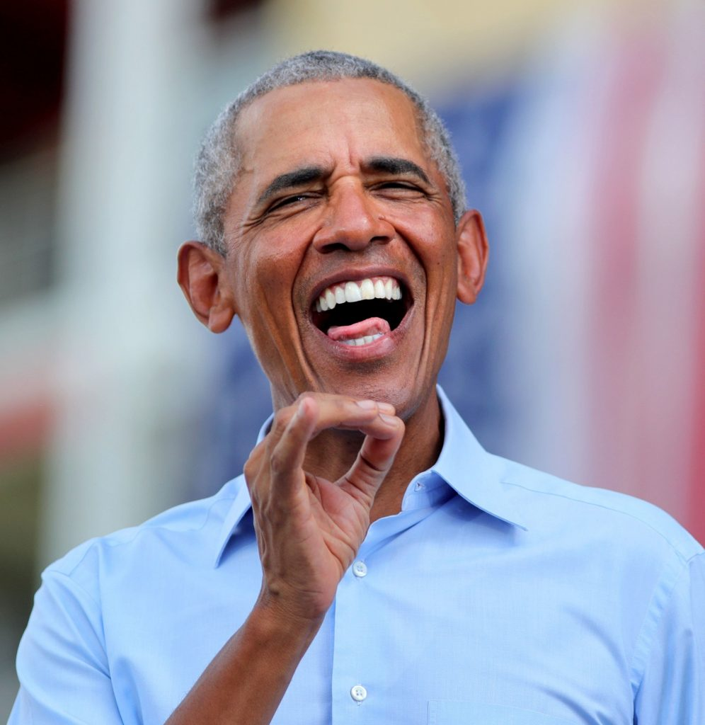 Former president Barack Obama responds to cheering supporters as he takes the stage in Orlando, Fla., to stump for Democratic presidential nominee Joe Biden, at a drive-in rally at Tinker Field, Tuesday, October 27, 2020.