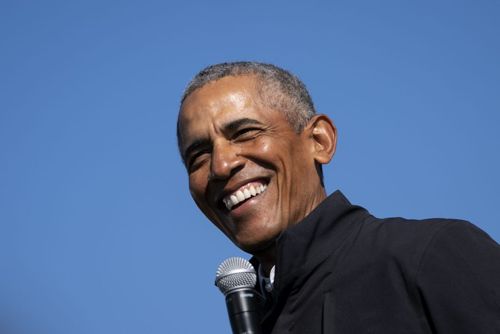 Former U.S. President Barack Obama speaks during a drive-in campaign rally for Democratic presidential nominee Joe Biden at Northwestern High School on October 31, 2020 in Flint, Michigan.