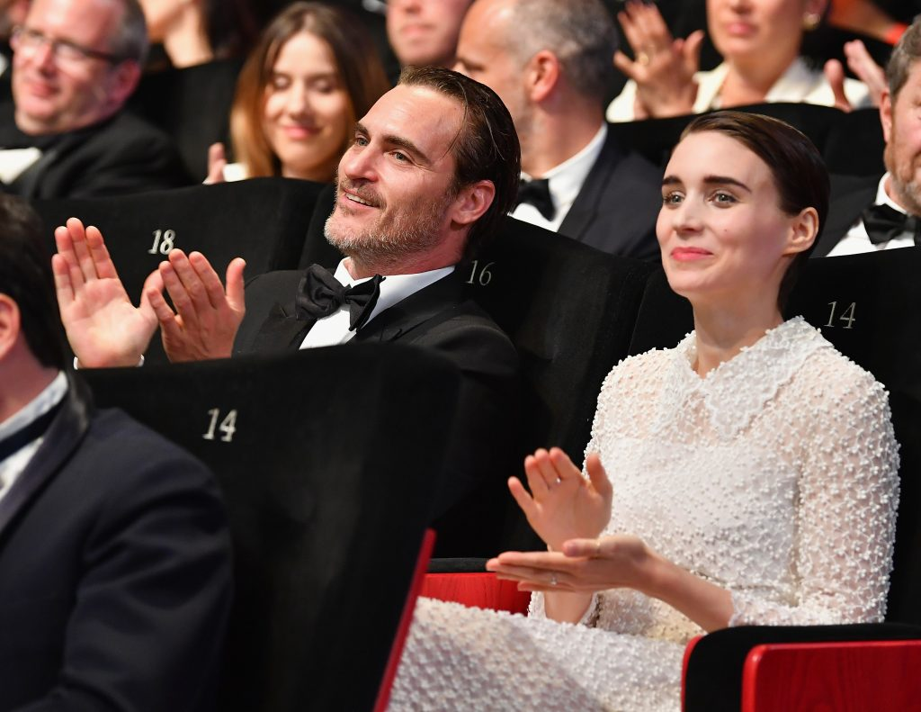 Joaquin Phoenix (L) and Rooney Mara applaud during the Closing Ceremony of the 70th annual Cannes Film Festival at Palais des Festivals on May 28, 2017 in Cannes, France.