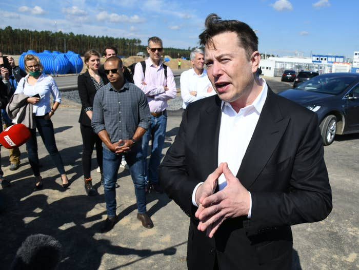 Elon Musk, head of Tesla, speaks to media representatives at the Tesla Gigafactory construction site In Grünheide near Berlin.