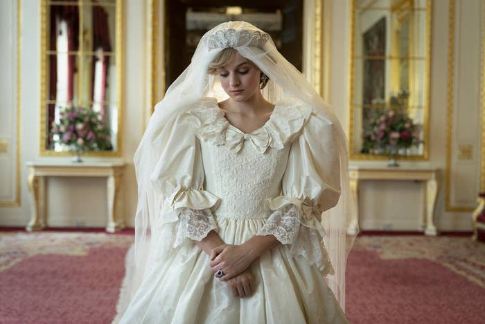 An actress dressed in wedding gown in an opulent setting to recreate the wedding of Princess Diana