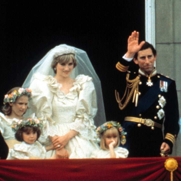 Princess Diana standing next to Prince Charles and Queen Elizabeth II on the Buckingham Palace after their wedding ceremony