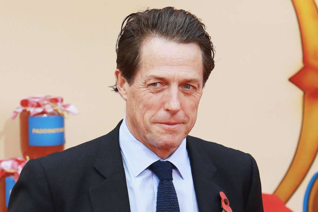 Hugh Grant Describes Grueling COVID-19 Battle – Jokes That His Eyeballs Were 'Too Big' For His Head