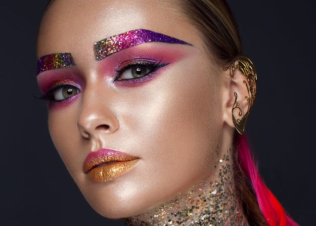 Glitter brows and colorful eyeshadow on a woman's face