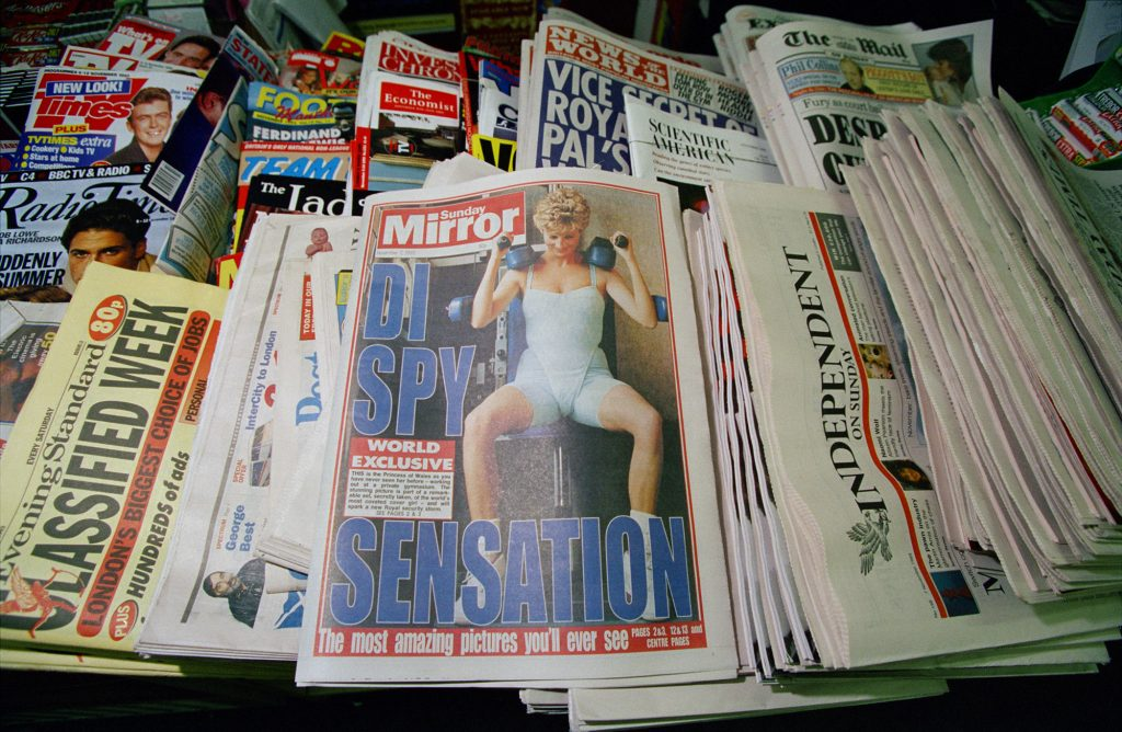 At centre is a copy of the Sunday Mirror, featuring a controversial, secretly-taken picture of Diana, Princess of Wales.