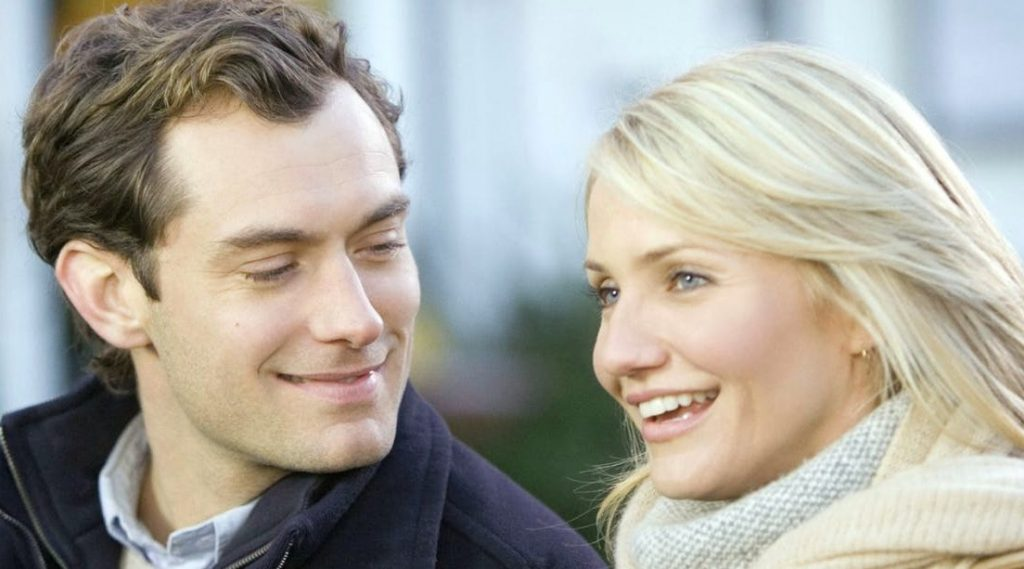 Still from The Holiday: Jude Law looks at Cameron Diaz with an affectionate smile