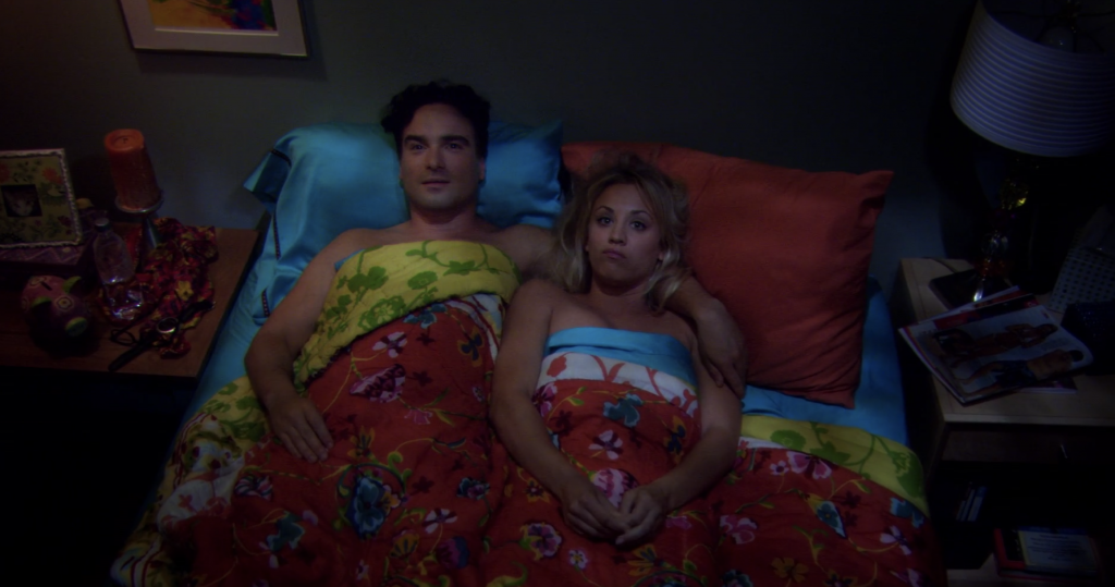 Leonard and Penny laying awkwardly in bed together