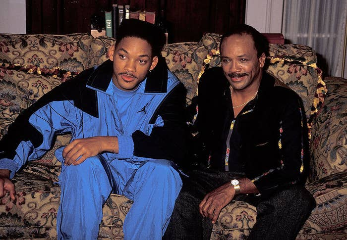 "Will Smith and Quincy Jones sitting on the couch on the set of ""The Fresh Prince of Bel-Air"""