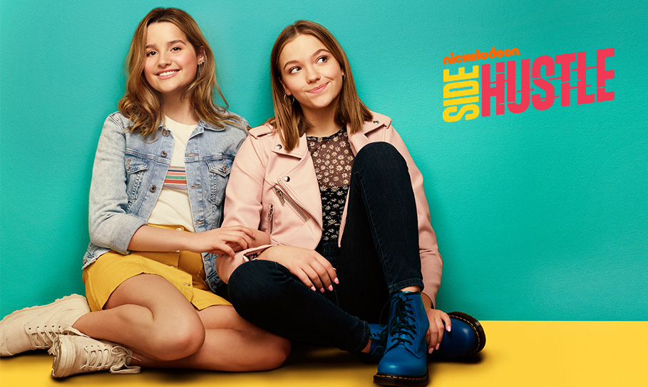 Promo graphic for 'Side Hustle' that shows Annie and Jayden's characters smiling and sitting on the floor