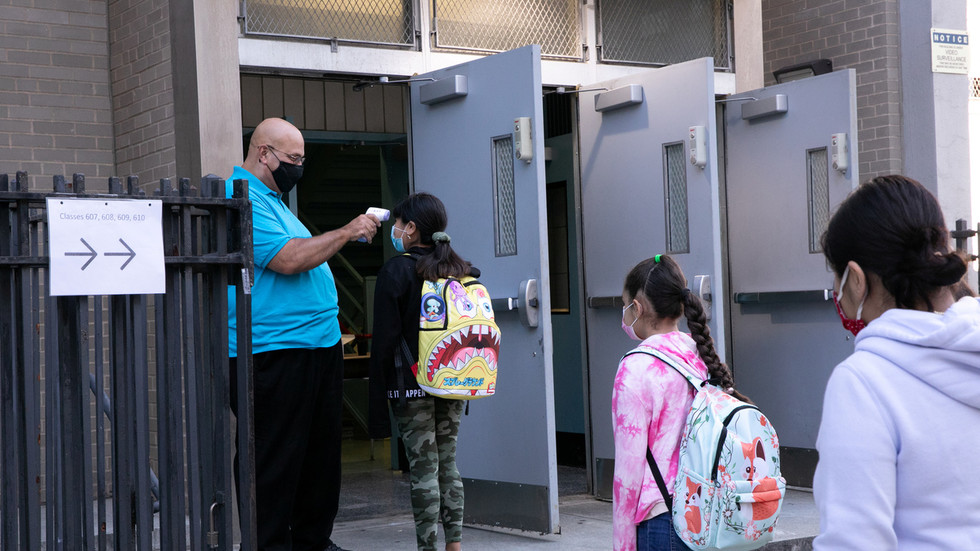NYC mayor reopens elementary schools under pressure from parents, but hints no return to norm without vaccine