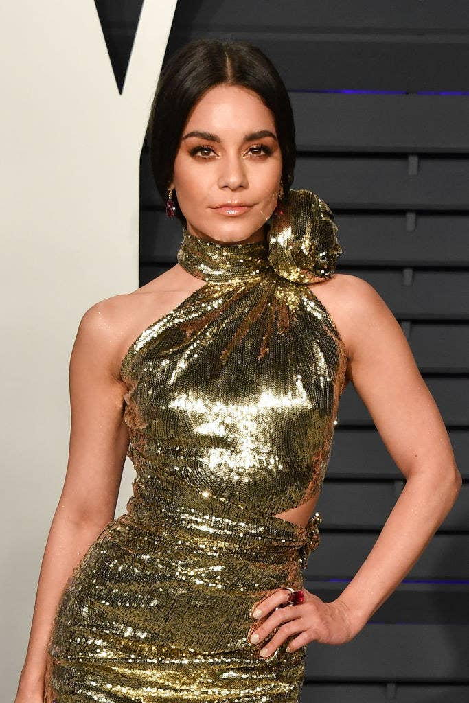 Vanessa posing in a sparkly form-fitting gown with a bow at the neck at the 2019 Vanity Fair Oscar Party