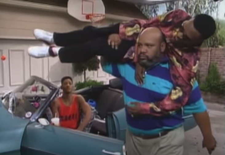 Uncle Phil carrying Jazz on his shoulder, ready to throw him inside the house