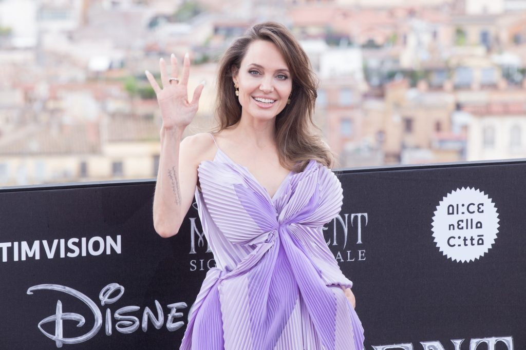 """Angelina Jolie wearing dress by Givenchy during the photocall of the film """"Maleficent - Lady of Evil"""" directed by Joachim Rønning, distributed by The Walt Disney Company"""