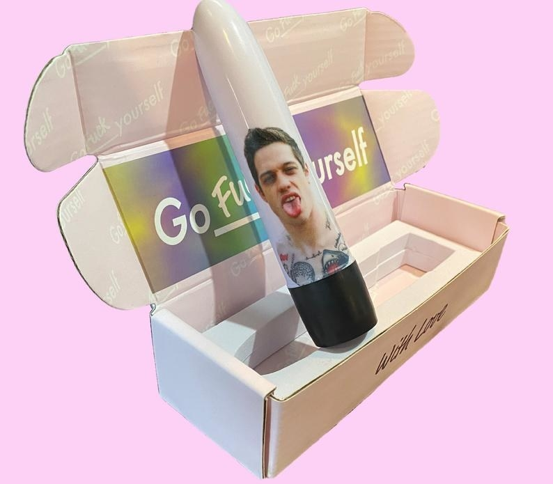 Side view of Pete Davidson vibrator inside of packaging