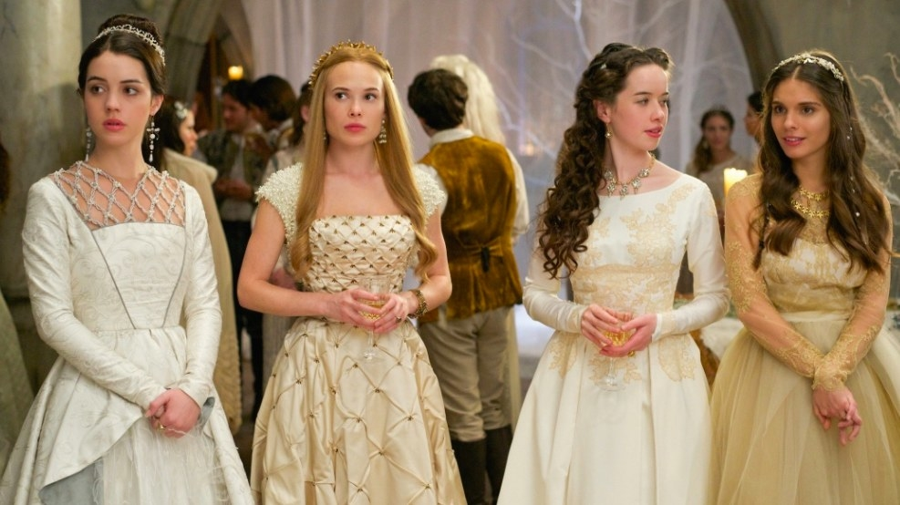 Mary and her ladies in waiting wear formal attire and stand in a row at a party in Reign