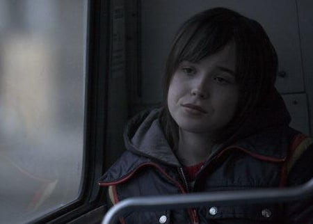 Tracey sitting on a bus