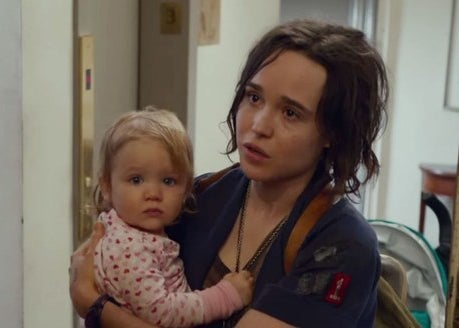 Tallulah holding a baby