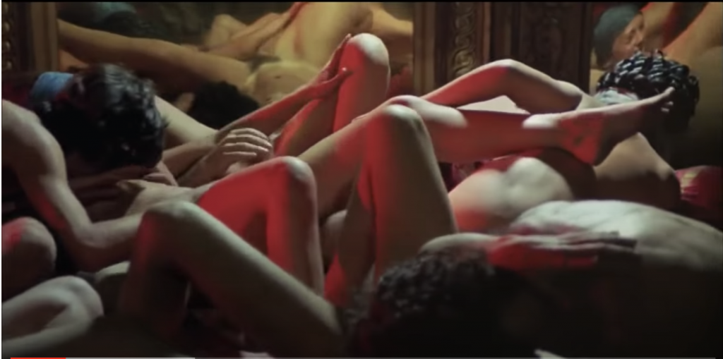 Naked people are piled atop each other in an orgy