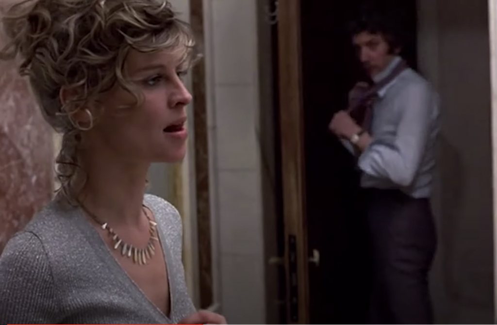 Julie Christie begins undressing as Donald Sutherland looks on