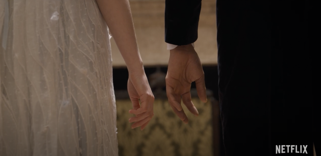 Daphne and Simon almost touching hands